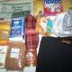 Новогодние подарки, продукты, капри, тапочки, средства личной гигиены