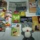 Новогодние подарки, сахар, сгущеное молоко, ананасы, паштет, икра трески, вафли, попкорн, чай, игрушки, литература