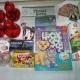 Новогодние подарки, пряники, чай, чоко бой, шоколадная паста, ананасы, горошек зеленый, икра трески, сахар, литература детская