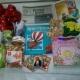 Новогодние подарки, ананасы, горошек зеленый, чай, икра трески, сахар, крекер, игрушки, литература детская, варежки