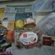 Новогодние подарки, паштет, сгущеное молоко, печенье, пряники, чай, раскраски
