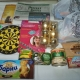Новогодние подарки, новогодние шары, ананасы, шпроты, сладости, игры
