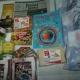 Новогодние подарки, сгущеное молоко, рыбные консервы, сахар, вафли, чокобой, чай, литература детская, пазлы