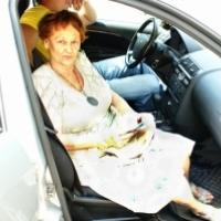 Тамара Александровна у нас в машине.